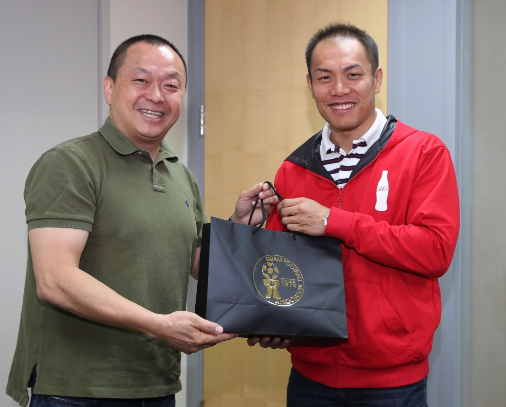 (Friday, February 27, 2015; Barrigada Heights, Guam) In the photo is Guam Football Association President Richard Lai (left) presenting a gift from GFA to Marcos Fong, CEO of Foremost Foods, Inc. & Coca-Cola Beverage Company (Guam) after signing a two-year partnership.